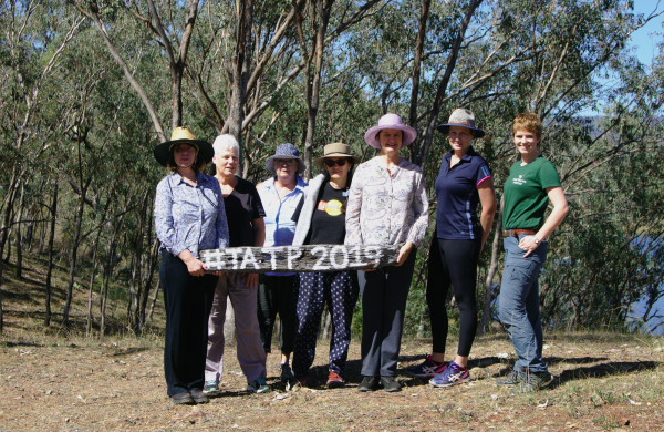 Just some of the women attending The Adventure Therapy Project Interpretative walk. Women attendants holding #TATP2019 sign painted on old fence post. Emma of Emma Walton Guiding, a nature guiding service of south east queensland, led the walk.